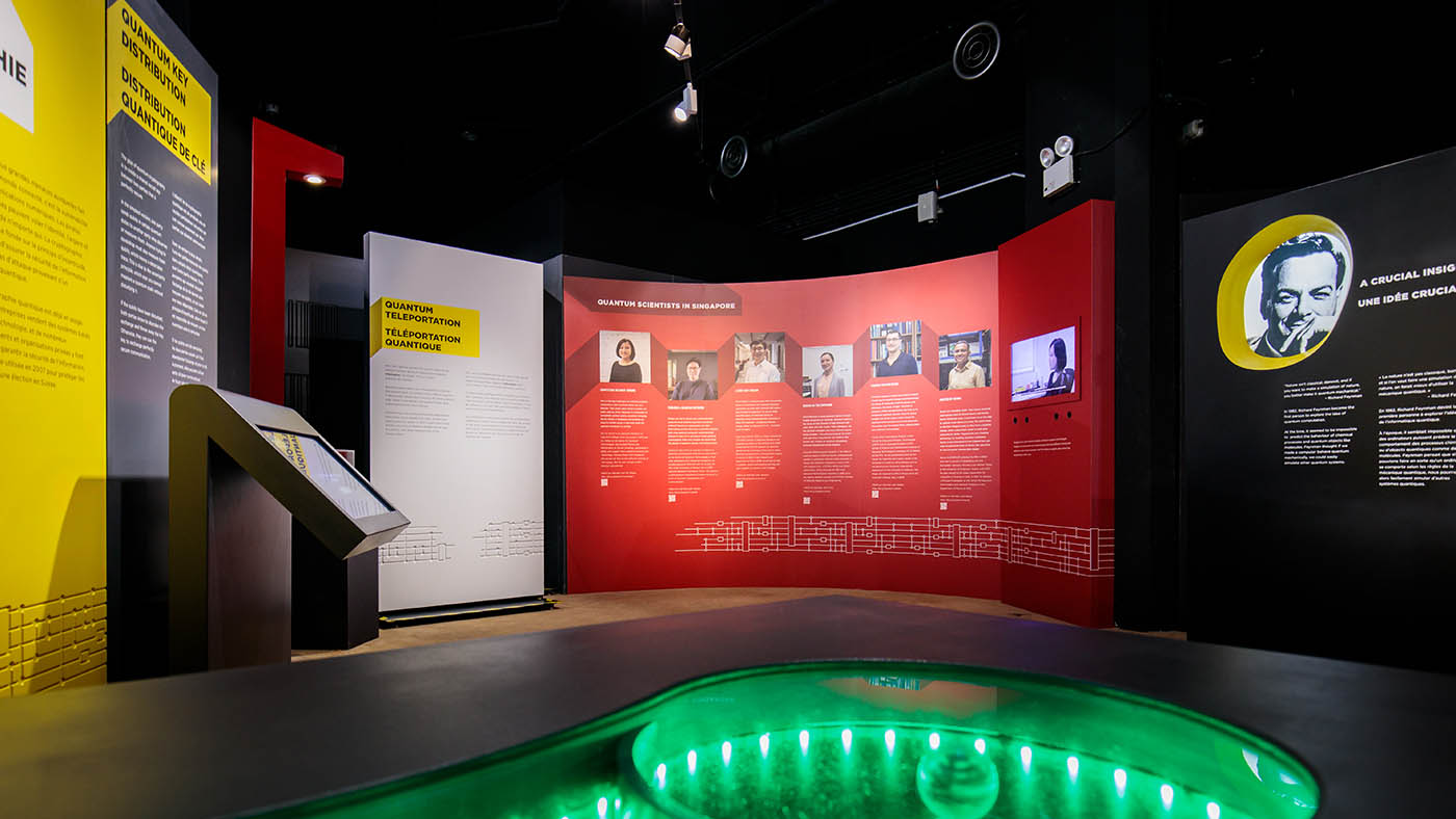 An inside view of Quantum: The Exhibition installed in Singapore, showing a panel that profiles local scientists