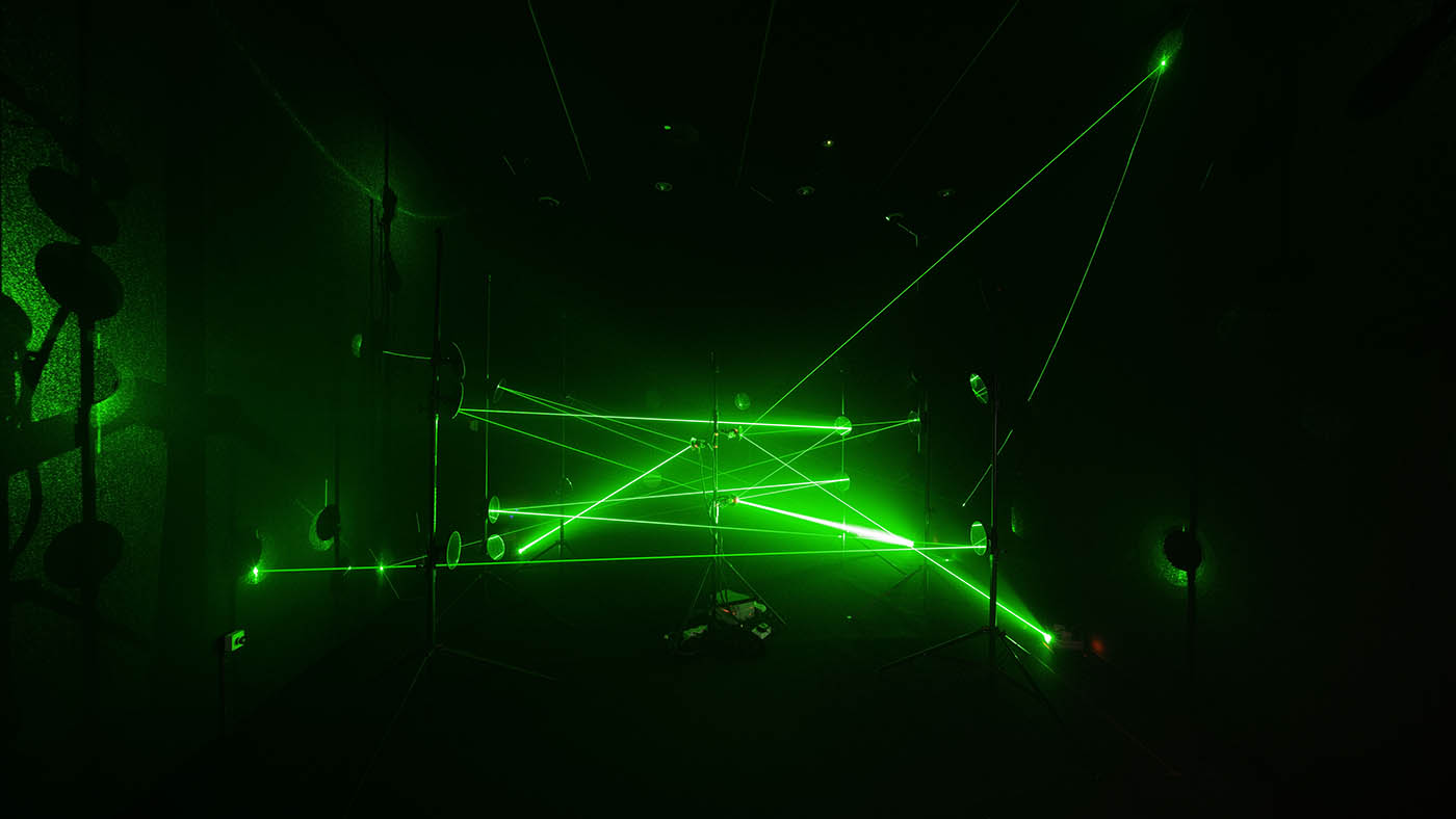 Quantum by Jun Ong is an installation artwork that uses green lasers and mirrors to create continuous laser paths