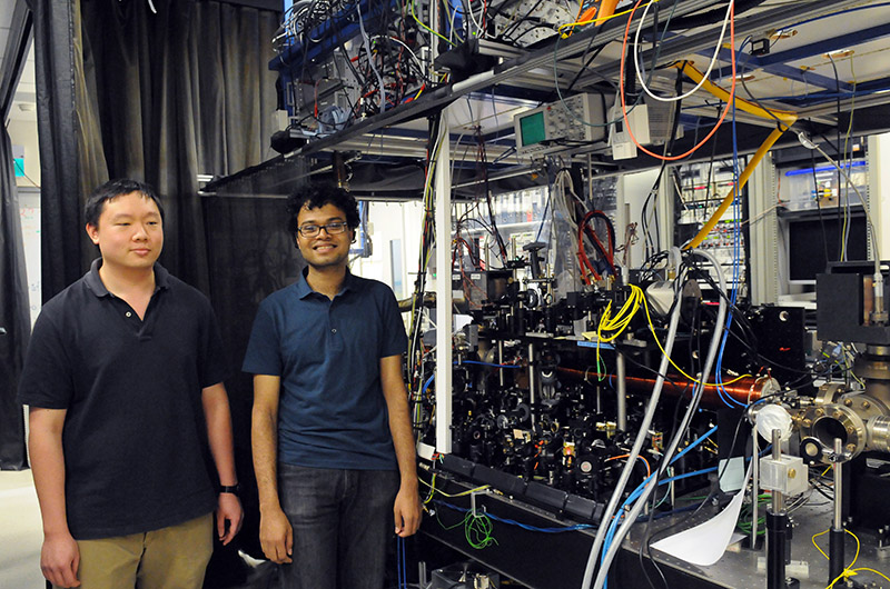 PhD Students Sambit Pal and Mark Lam with a cold fermion experiment at the Centre for Quantum Technologies.