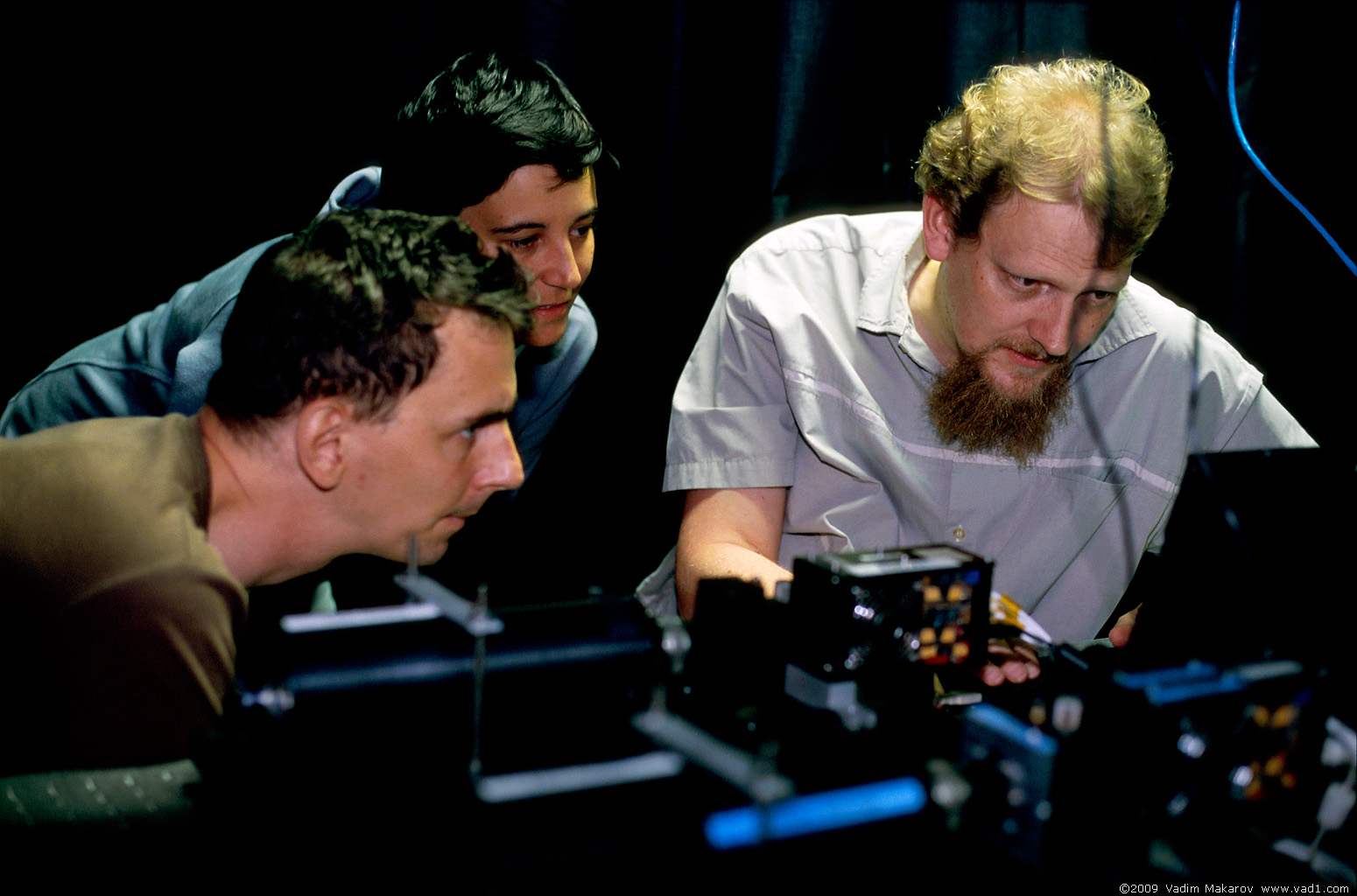 Picture of CQT researchers setting up a quantum cryptography system