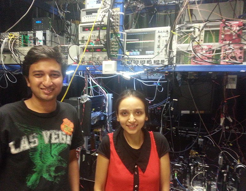 PhD students Bharath Srivathsan and Gurpreet Kaur Gulati with their quantum experiment at the Centre for Quantum Technologies in Singapore